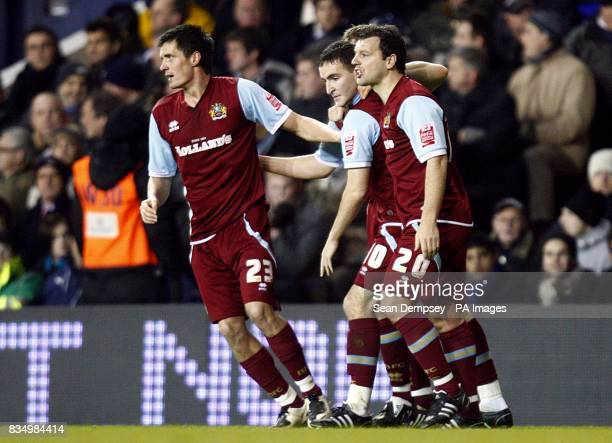 Burnley's Martin Paterson celebrates with his team mates after scoring the opening goal of the game