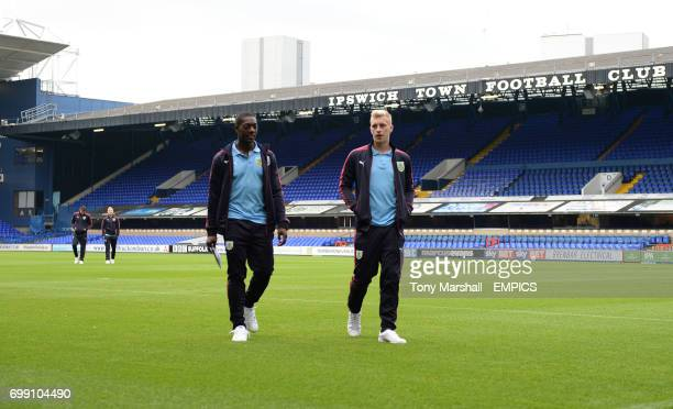 Burnley's Marvin Sordell and Rouwen Hennings walk back to the dressing room after looking at the Portman Road pitch