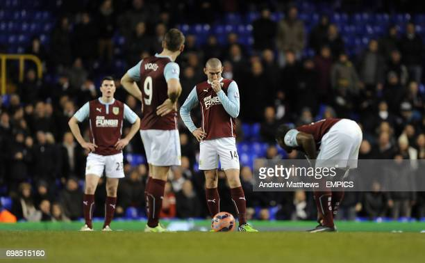 Burnley's Marvin Sordell David Jones Sam Vokes and Michael Keane looks dejected after Tottenham Hotspur's Etienne Capoue scores his side's second...