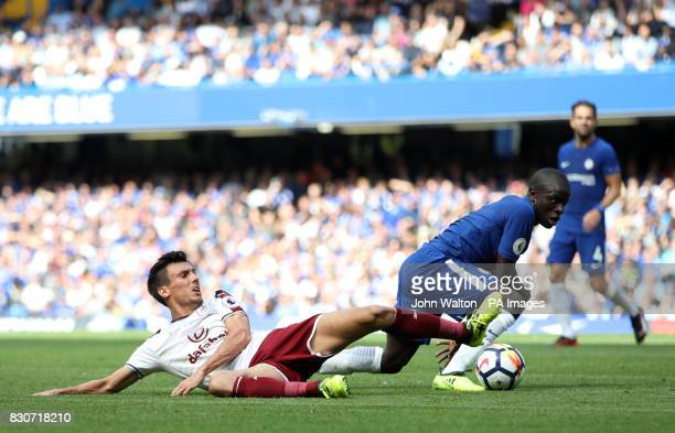 Burnley's Matthew Lowton and Chelsea's N'Golo Kante battle for the ball during the Premier League match at Stamford Bridge London