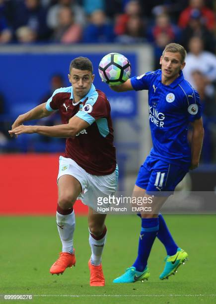 Burnley's Matthew Lowton and Leicester City's Marc Albrighton battle for the ball