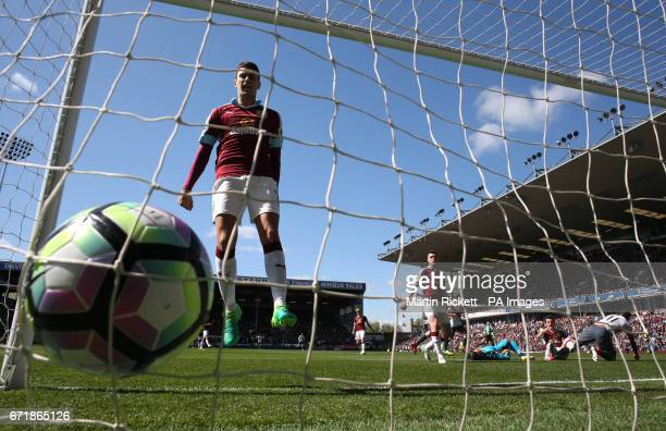 Burnley's Matthew Lowton reacts after seeing Manchester United's Anthony Martial score his side's first goal of the game during the Premier League...