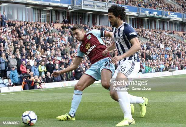 Burnley's Matthew Lowton vies for possession with West Bromwich Albion's Ahmed Hegazy during the Premier League match between Burnley and West...