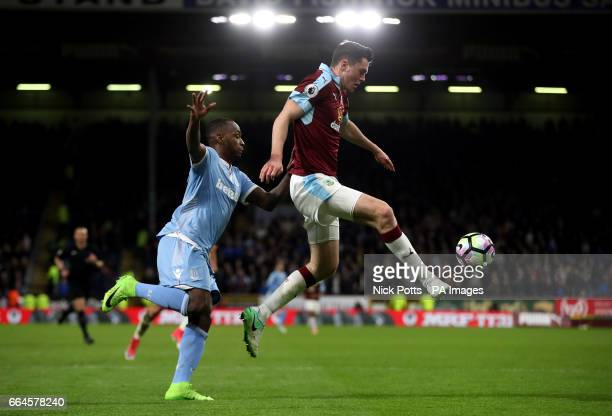 Burnley's Michael Keane and Stoke City's Saido Berahino battle for the ball during the Premier League match at Turf Moor Burnley