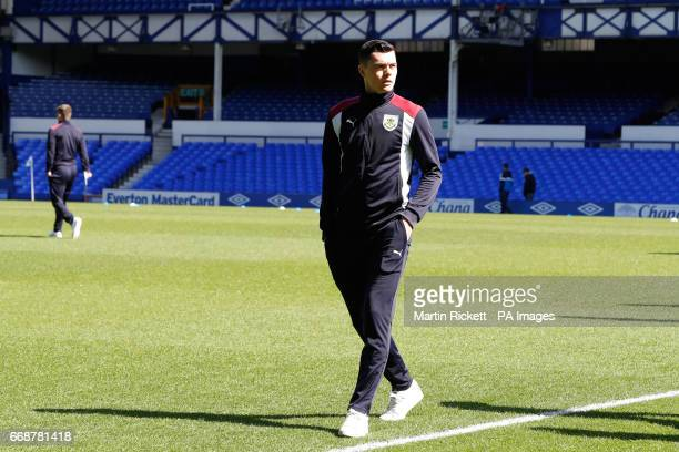 Burnley's Michael Keane inspects the pitch before the Premier League match at Goodison Park Liverpool