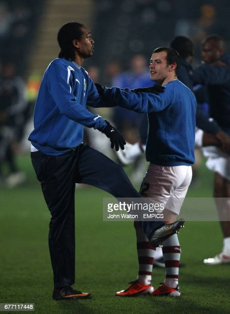 Burnley's Nathan Delfouneso and Ross Wallace stretch during the warm up