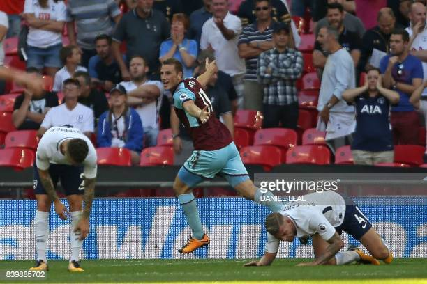 Burnley's New Zealand striker Chris Wood celebrates after scoring their late equalizer during the English Premier League football match between...