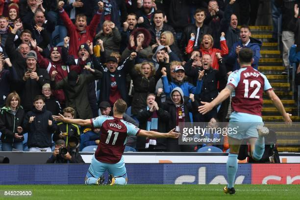 Burnley's New Zealand striker Chris Wood celebrates scoring his team's first goal during the English Premier League football match between Burnley...