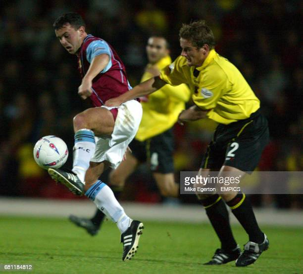 Burnley's Paul Weller and Watford's Neal Ardley battle for the ball