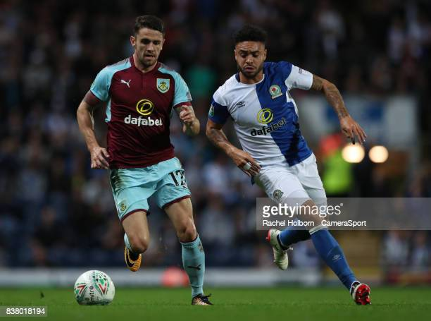 Burnley's Robbie Brady and Blackburn Rovers' Derrick Williams during the Carabao Cup Second Round match between Blackburn Rovers and Burnley at Ewood...