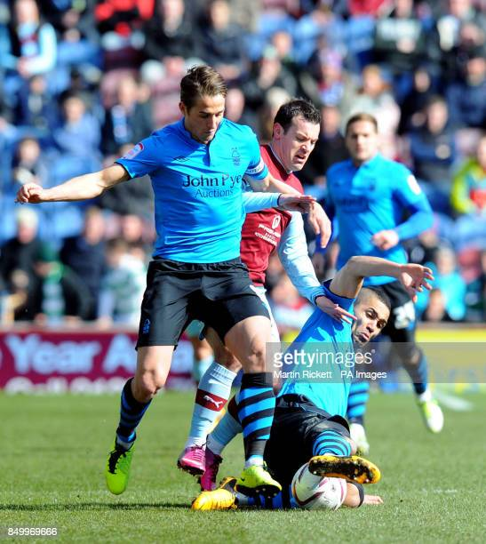 Burnley's Ross Wallace battles for the ball with Nottingham Forest's Chris Cohen and Lewis McGugan during the npower Football League Championship...