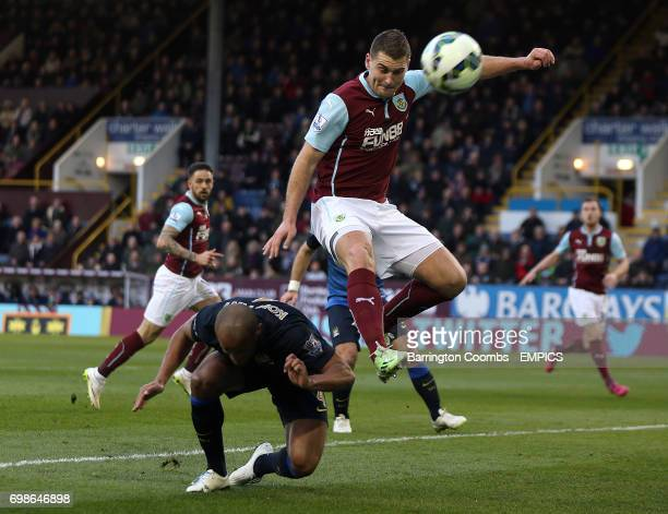 Burnley's Sam Vokes and Manchester City's Vincent Kompany battle for the ball