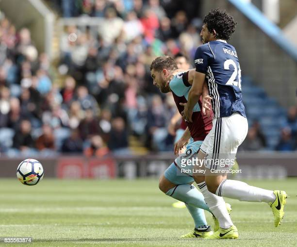 Burnley's Sam Vokes holds off the challenge from West Bromwich Albion's Ahmed Hegazy during the Premier League match between Burnley and West...