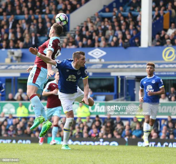 Burnley's Sam Vokes just fails to connect with this cross under pressure from Everton's Morgan Schneiderlin during the Premier League match between...