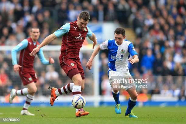 Burnley's Sam Vokes takes on Blackburn Rovers' Corry Evans