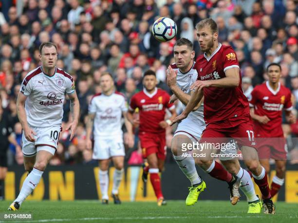 Burnley's Sam Vokes vies for possession with Liverpool's Ragnar Klavan during the Premier League match between Liverpool and Burnley at Anfield on...
