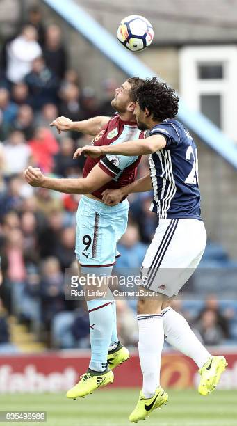Burnley's Sam Vokes vies for possession with West Bromwich Albion's Ahmed Hegazy during the Premier League match between Burnley and West Bromwich...