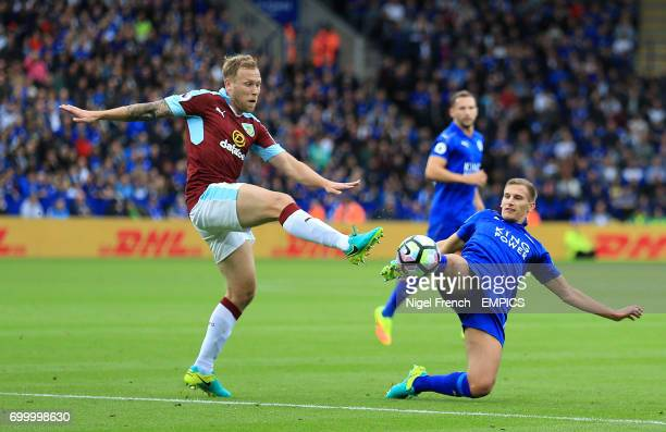 Burnley's Scott Arfield and Leicester City's Marc Albrighton battle for the ball