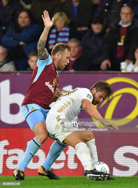 Burnley's Scott Arfield battles with Leeds United's Gaetano Berardi during the Carabao Cup Third Round match between Burnley and Leeds United at Turf...