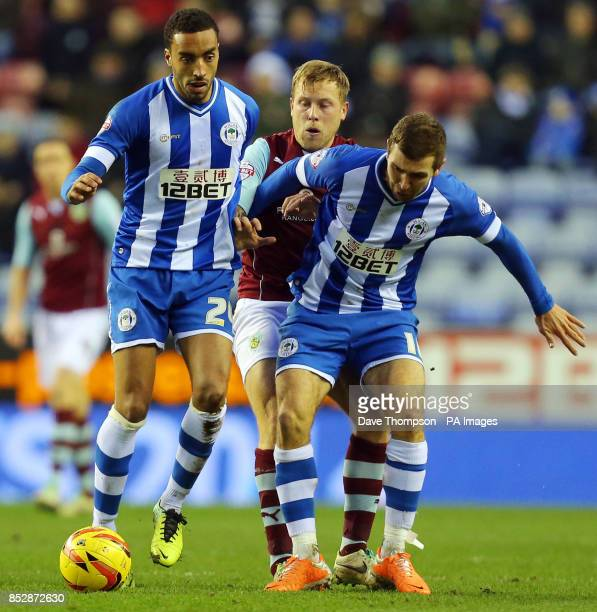 Burnley's Scott Arfield is kept out by Wigan Athletic's James Perch and Wigan Athletic's James McArthur during the Sky Bet Championship match at the...