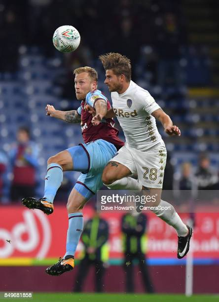 Burnley's Scott Arfield out jumps Leeds United's Gaetano Berardi during the Carabao Cup Third Round match between Burnley and Leeds United at Turf...