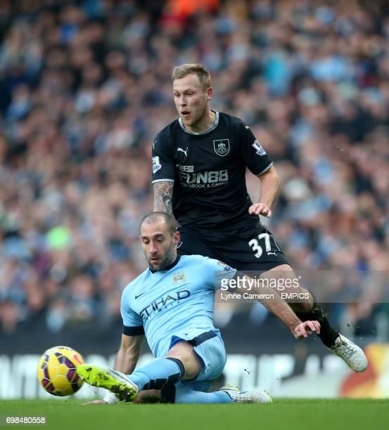 Burnley's Scott Arfield runs at Manchester City's Pablo Zabaleta