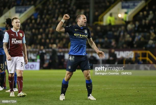 Burnley's Scott Arfieldf looks on as Manchester City's Pablo Zabaleta appeals for a penalty