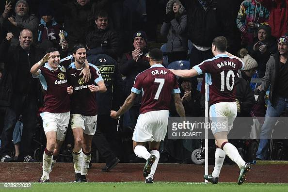 Burnley's Scottish midfielder George Boyd celebrates with teammates after scoring their third goal during the English Premier League football match...