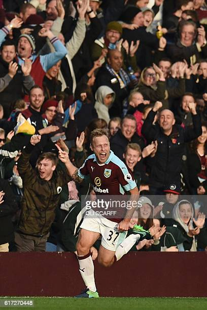 Burnley's Scottish midfielder Scott Arfield celebrates scoring their second goal during the English Premier League football match between Burnley and...