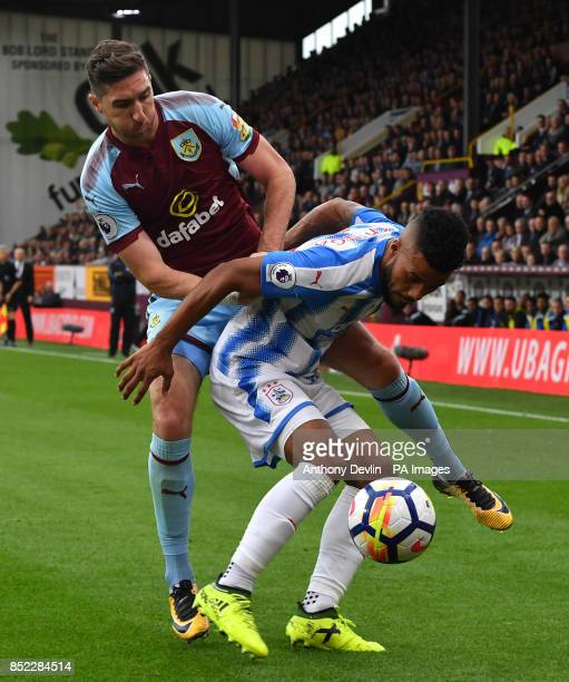 Burnley's Stephen Ward and Huddersfield Town's Elias Kachunga battle for the ball during the Premier League match at Turf Moor Burnley