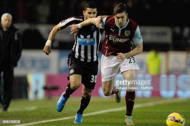 Burnley's Stephen ward holds off Newcastle United's Mehdi Abeid