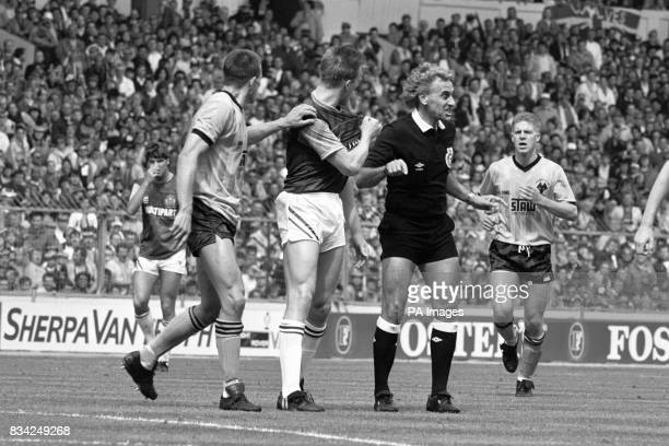 Burnley's Steve Davis defending his actions to the referee after a tackle on Wolverhampton Wanderers' goalscorer Andy Mutch
