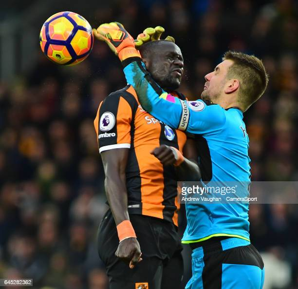 Burnley's Thomas Heaton vies for possession with Hull City's Oumar Niasse during the Premier League match between Hull City and Burnley at KCOM...