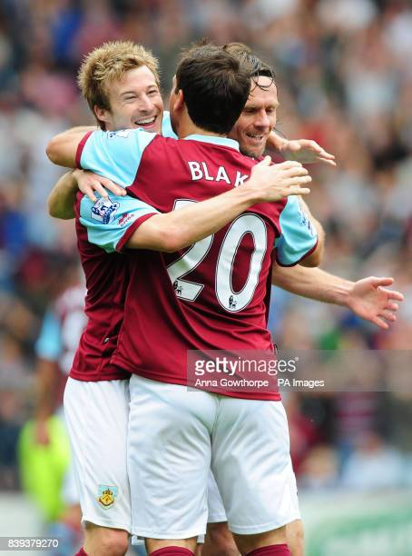 Burnley's Wade Elliott celebrates his goal with Robbie Blake and Graham Alexander during the Barclays Premier League match at Turf Moor Burnley
