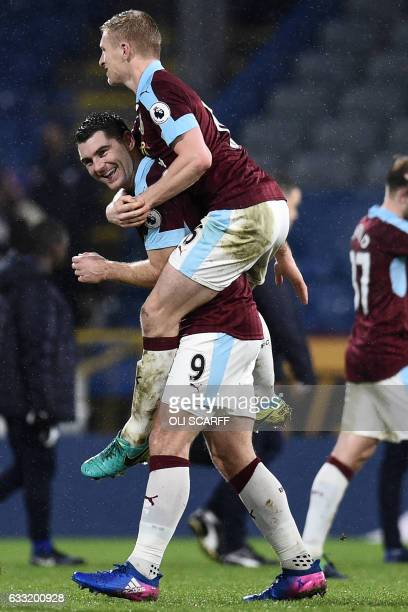 Burnley's Welsh striker Sam Vokes celebrates with Burnley's English defender Ben Mee on the pitch after the English Premier League football match...