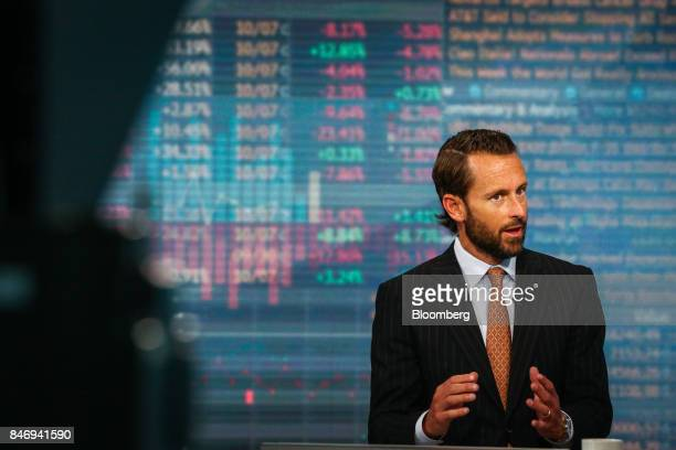 Burns McKinney cochief investment officer of Allianz Global Investors US LLC speaks during a Bloomberg Television interview in New York US on...