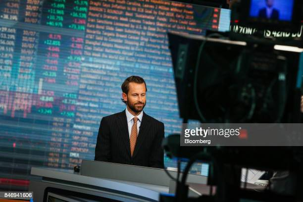 Burns McKinney cochief investment officer of Allianz Global Investors US LLC smiles during a Bloomberg Television interview in New York US on...