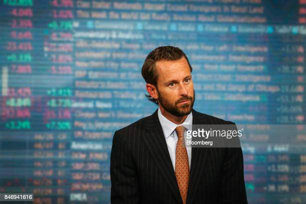 Burns McKinney cochief investment officer of Allianz Global Investors US LLC listens during a Bloomberg Television interview in New York US on...