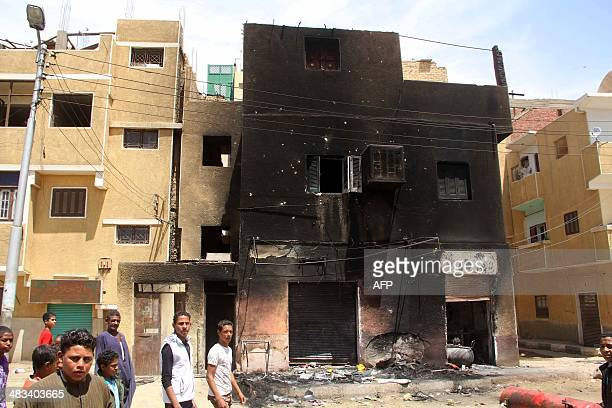 A burnt building is seen in the southern Egyptian city of Aswan on April 6 2014 following tribal clashes which killed at least 23 people Longstanding...