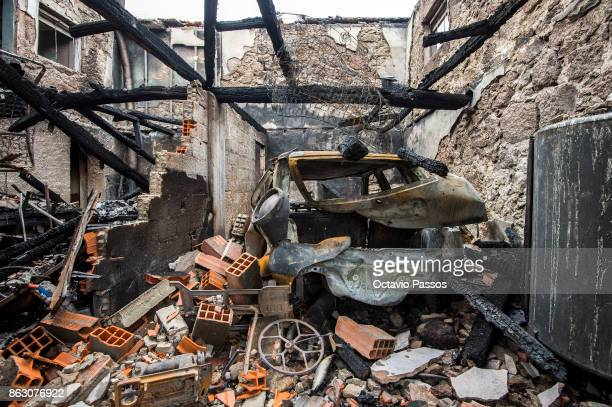 A burnt car remains inside a house in the village of Vila Nova near Vouzela on October 19 2017 in Viseu Portugal Portugal's forest fires broke out on...