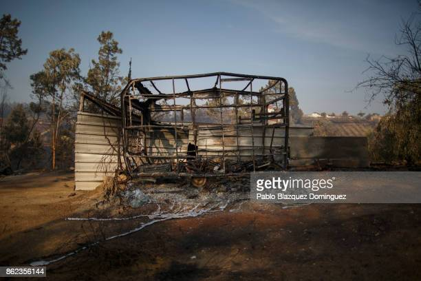 A burnt caravan stands in the village of Sao Pedro de Alva near Penacova on October 17 2017 in Coimbra region Portugal At least 37 people have died...