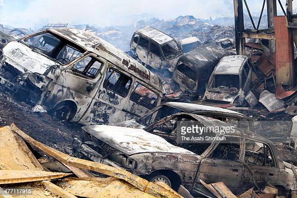 Burnt cars by the fire occered after a 90 magnitude strong earthquake and subsequent tsunami struck on March 12 2011 in Kesennuma Miyagi Japan The...