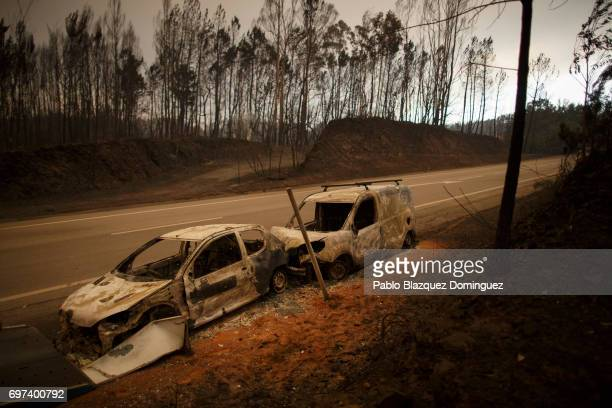 Burnt cars stand on the side of the roads after a wildfire took dozens of lives on June 18 2017 near Castanheira de Pera in Leiria district Portugal...