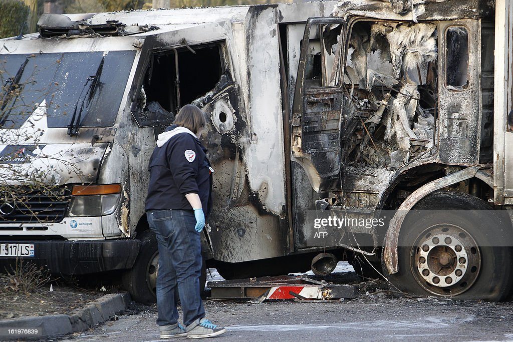 A burnt cash-in-transit (CIT) vehicle is seen after an attack in Bois-Guillaume, near Rouen, northwestern France, on February 18, 2013. Two CIT security staff were slightly injured.