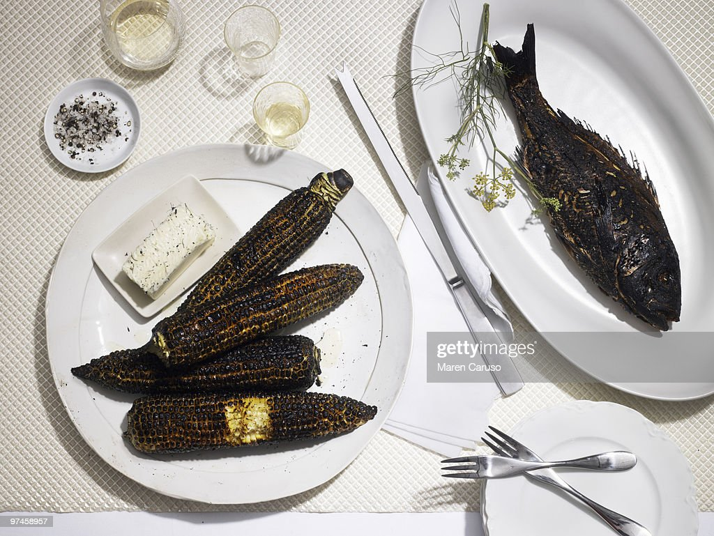 Burnt dinner of fish and corn