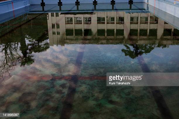 Burnt elementary school building is reflected in the swimming pool February 29 2012 in Ishinomaki Miyagi prefecture in Japan A Massive tsunami hit...