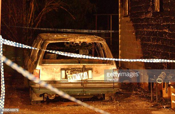 Burnt out car in the garage at Korong vale 19th March 2005 THE AGE NEWS Picture by WAYNE HAWKINS