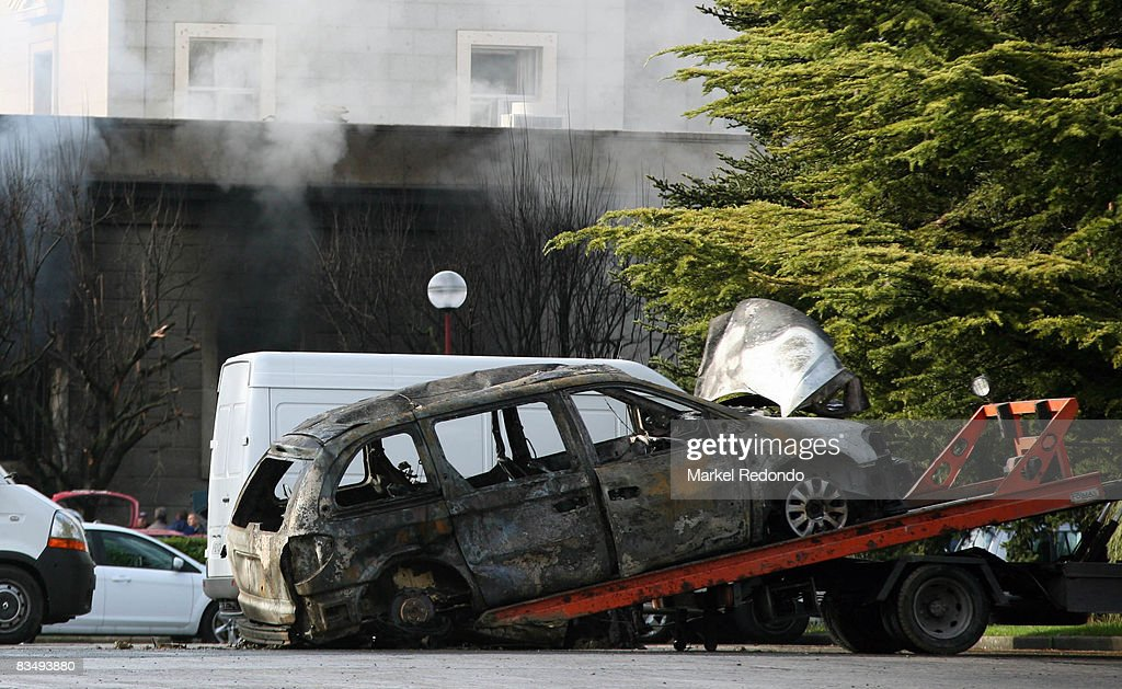 A burnt out car is removed from the scene of a car bomb on October 30 2008 at the University of Navarra in Pamplona Spain At least 15 people were...