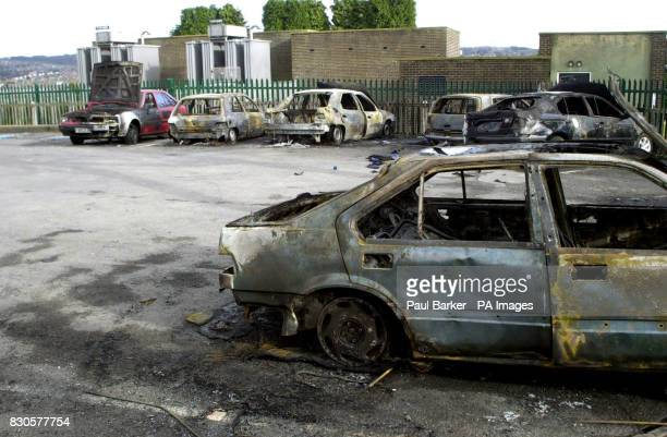 Burnt out cars in the car park of the Coach House pub in the Liggett Green area of Bradford the morning after hundreds of youths ran amok in the...