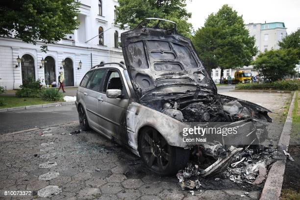 Burnt out cars in the street during the 'Welcome to Hell' antiG20 protest march on July 7 2017 in Hamburg Germany Authorities are braced for...